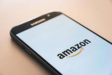 Image of smartphone with the Amazon logo displayed.